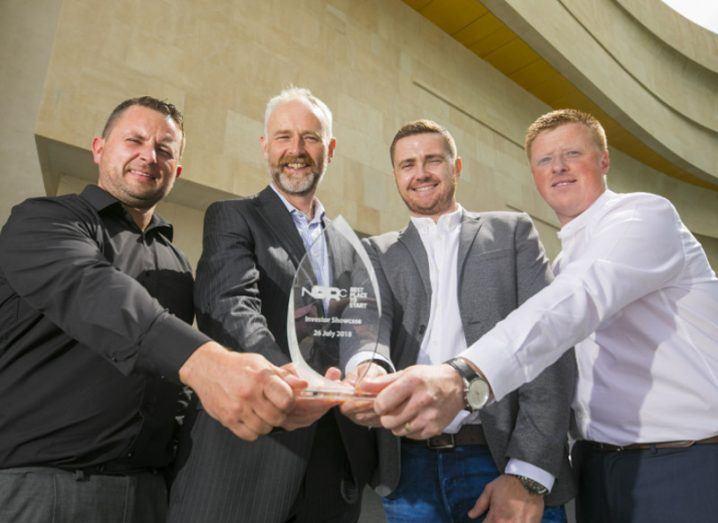 Four men holding a tech award.