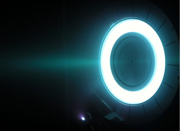A white ring with a dark centre against a black background, similar to a plasma thruster.