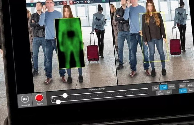 A computer screen showing the Thruvision technology scanning passengers for weapons.