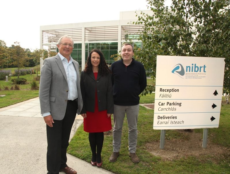 Dominic Carolan, Dr Geraldine Canny, and Dr Colin standing outside the NIBRT campus.