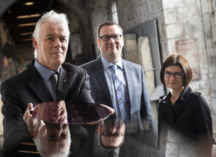 Prof Cian Ó Mathuna, Kieran Meade, Dr Aleksandra Augustyniak smiling in business clothing.