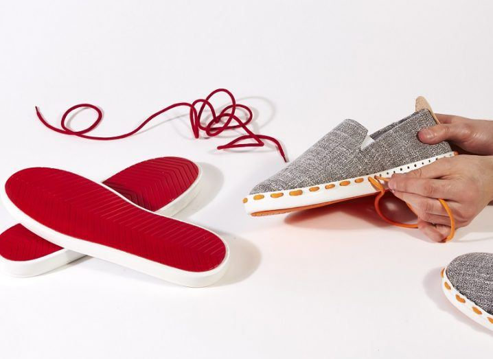 A grey biodegradable Layer show with red soles.