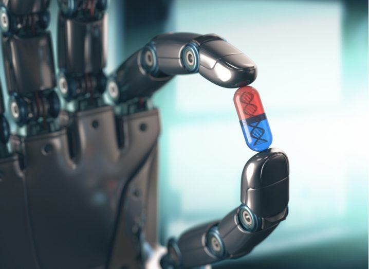 robotic hand holding red and blue pill.