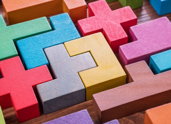 Colourful wooden blocks slotting together, symbolising a puzzle.