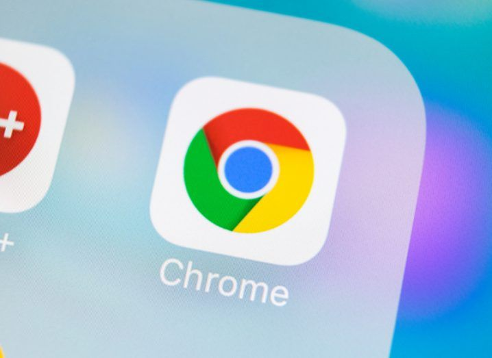 Google Chrome app logo on a mobile device with a purple background