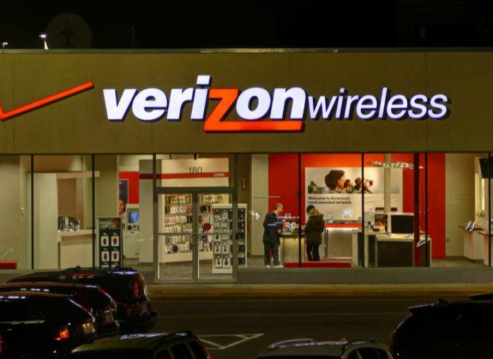 A Verizon Wireless shopfront at night.