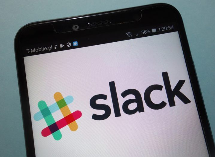 Slack logo, a colourful hash sign on a mobile phone.