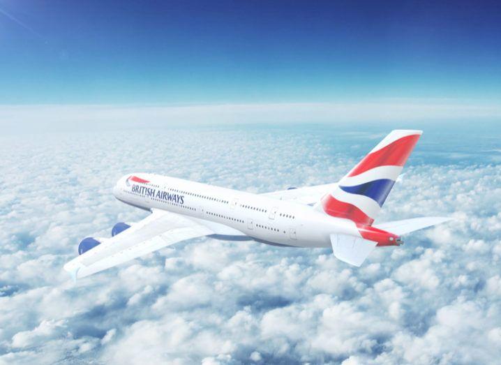 British Airways jet flying above fluffy white clouds.
