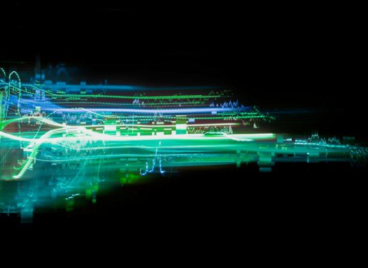 An abstract image of a computer glitch featuring blue light waves on a black background.