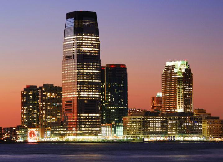 The Goldman Sachs tower in Jersey City, New Jersey illuminated at sunset.