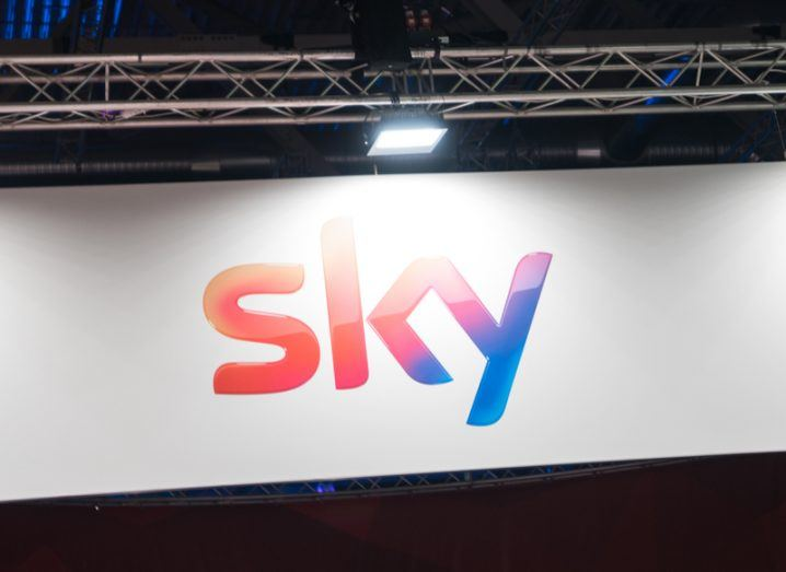 Picture of logo of TV service Sky under lights in a TV studio.