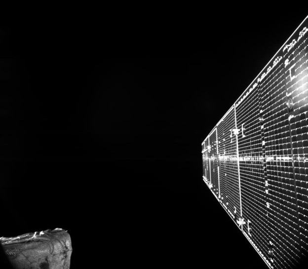 A black and white image of a BepiColombo solar array against the black of space.