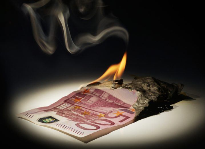 A photo of a 500 euro note on fire.