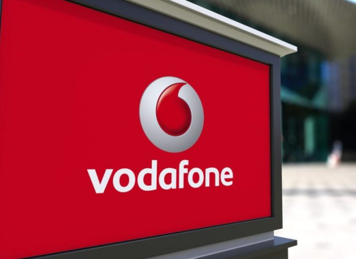 Street advert displaying Vodafone logo.