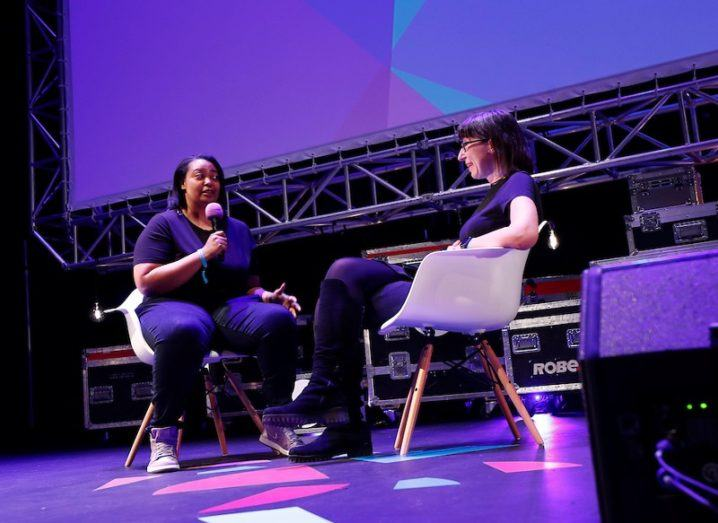 Arlan Hamilton and Ann O'Dea sitting and chatting on stage at Inspirefest 2018.