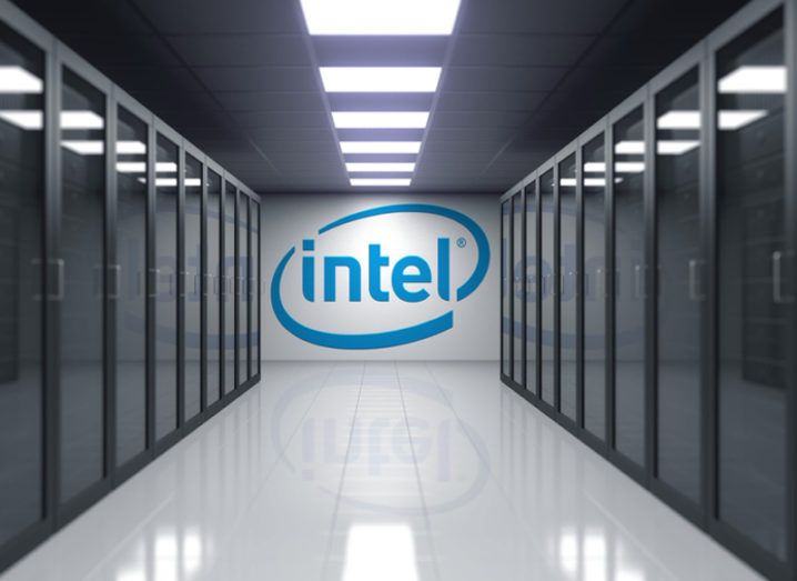 A view inside an intel data centre with blue intel logo written on a white wall.