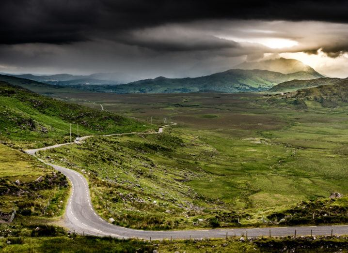 Beautiful scenery in Kerry showing a valley under a dark cloudy sky.