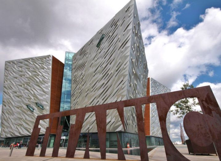 Titanic Museum in Belfast under a blue-grey sky.