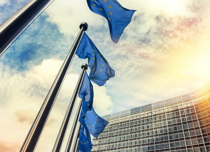Waving EU flags outside the European Commission in Europe.
