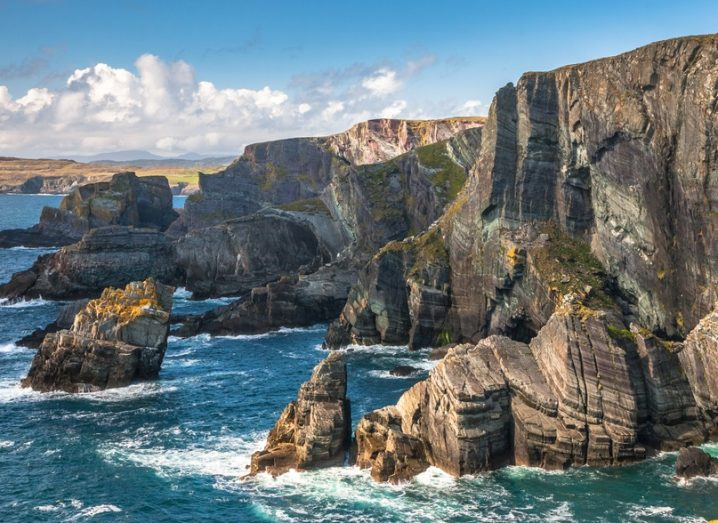 The coast of Mizen Head, Co Cork. Brightly lit cliff faces and deep blue water