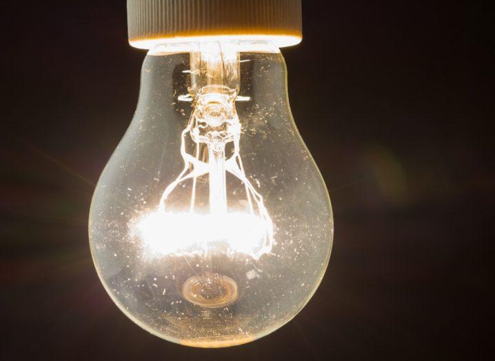 A bright incandescent light bulb, symbolising a brainwave or idea.