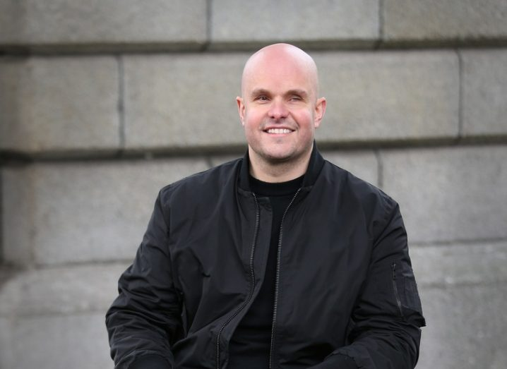 Mark Pollock photographed sitting outside Trinity College Dublin, sitting in his wheelchair,