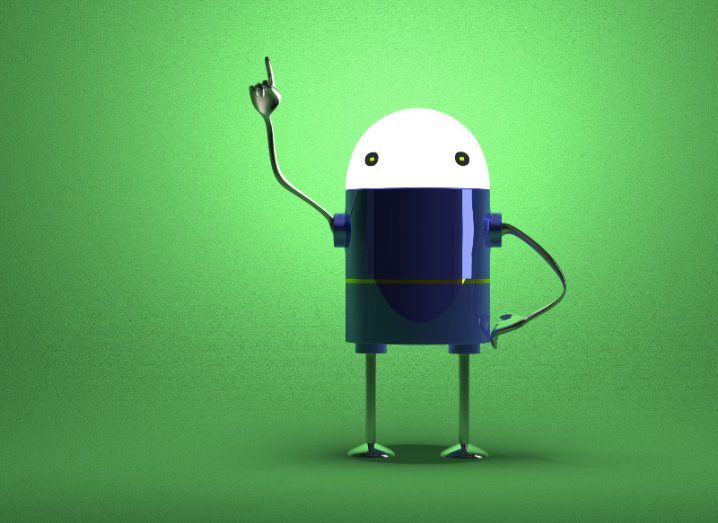 A robot with arm in the air against green background, symbolising Google objecting to fine.