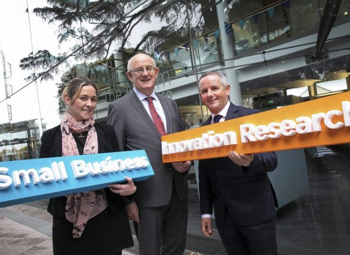 From left: Nicola Graham, Tom Kelly and Paul Reid holding SBIR signs.