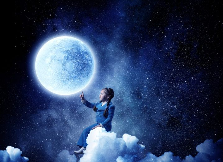 A young girl sits on a cloud and touches the moon.