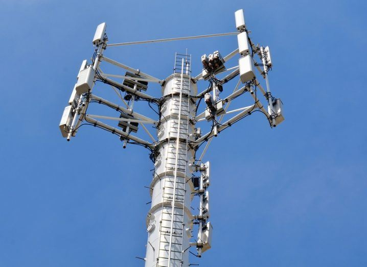 5G mobile antenna against backdrop of a blue sky.