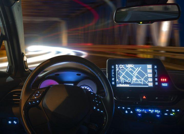 Concept of an autonomous car cockpit at night with traffic coming the other way.