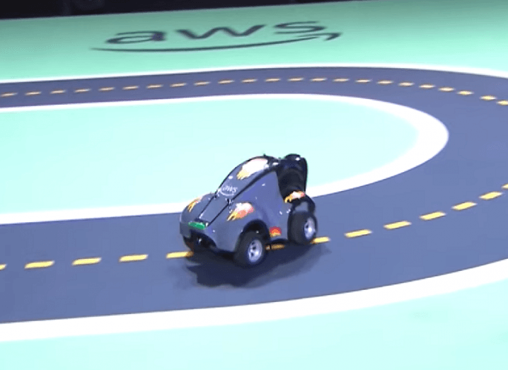 The autonomous AWS DeepRacer car on a small test track.