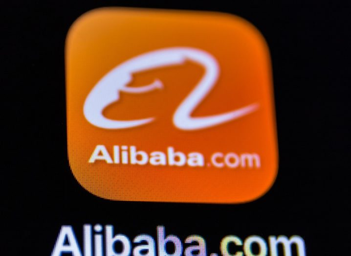 The Alibaba app icon on a mobile device. An orange square with a letter A in centre.