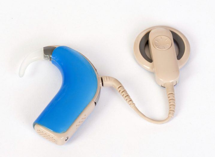 A cochlear implant with a blue sound-processor earpiece.