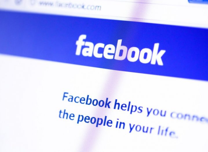 Facebook logo on website homepage, open on a laptop.