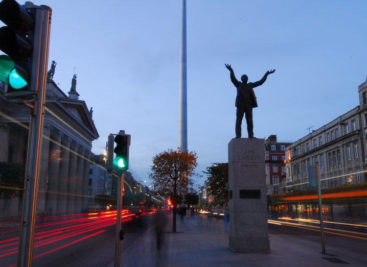 Image of Jim Larkin statue in Dublin with lights blurred.