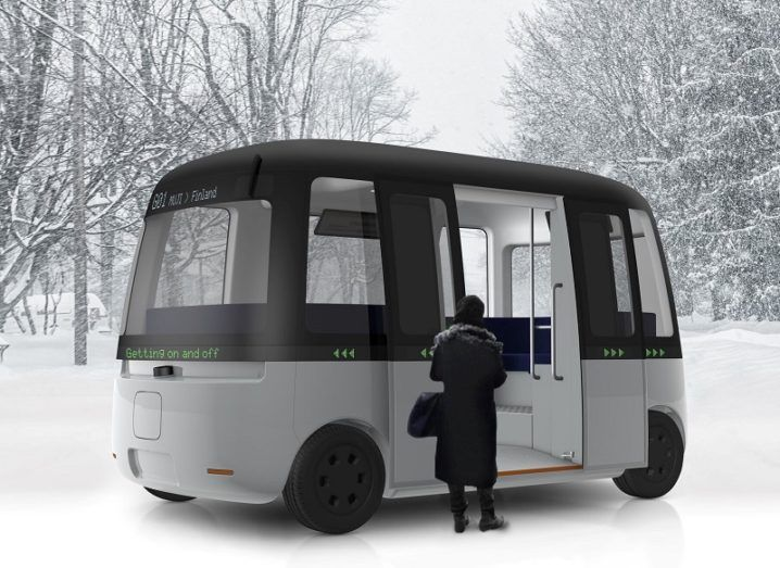 The Gacha bus concept with a passenger entering against a snowy background.