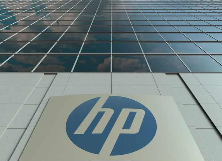 Close up of a HP logo on a glass building.