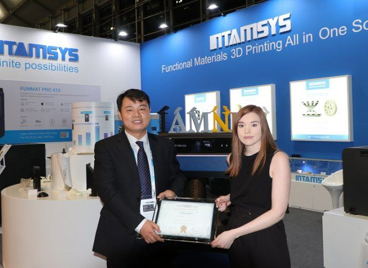 Charles Han, CEO of INTAMSYS, and Dr Sarah Brady of I-Form holding the award at the event.