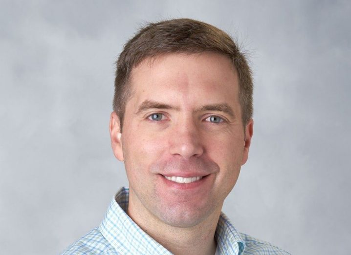 Kurt Rohloff smiling, wearing a blue checked shirt.