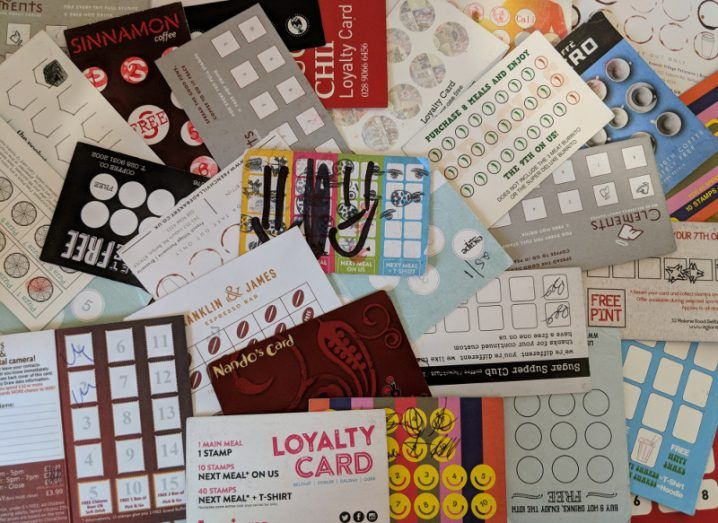 pile of different loyalty cards scattered across a surface.