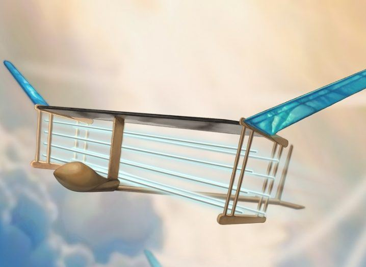 Illustration of the MIT aircraft with wired wings and flaps flying through clouds.