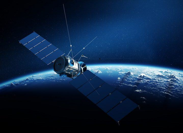 Communications satellite in orbit around Earth.