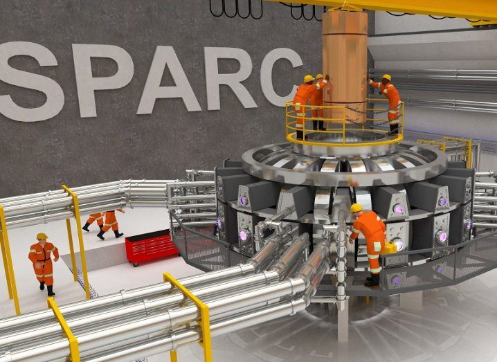 A rendition of the Sparc nuclear fusion reactor with scientists working on it.