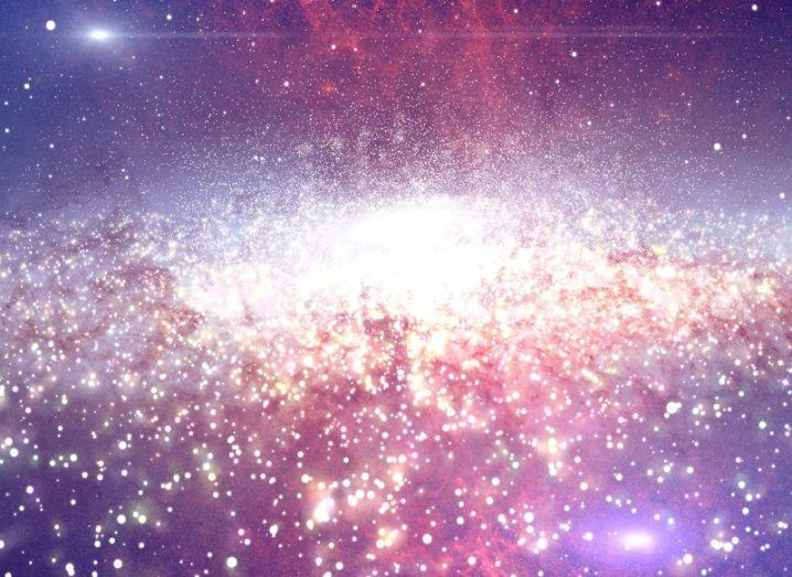 colourful galaxy horizon in pink and purple with white yellow glow in centre.