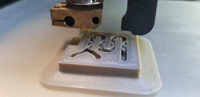 Close-up of the winning 3D printed design being made.