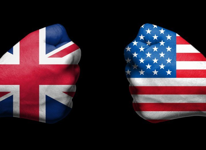 two fists emblazoned with the flags of the UK and US face each other.