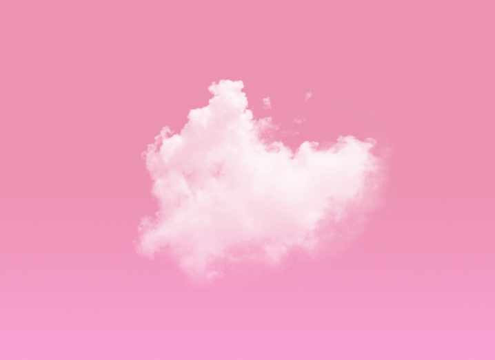 A light pink cloud in front of a darker pink sky.