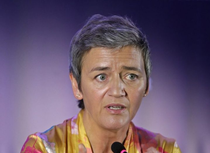 EU Commissioner Margrethe Vestager speaks to the journalists during a press conference at the Web Summit, wearing a yellow blouse.