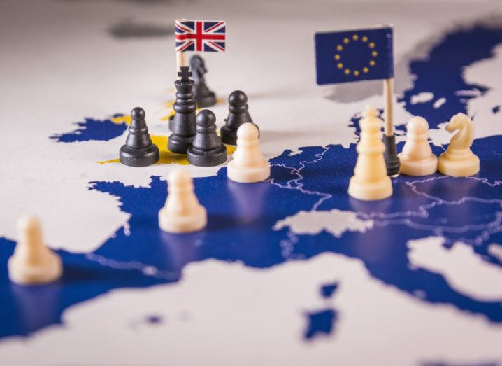 Chess pieces on a map of europe with EU countries as white piece and UK as black pieces.